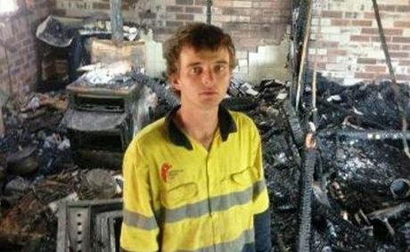 Jade Pearce stands in what remains of his home after it was destroyed by fire this month.