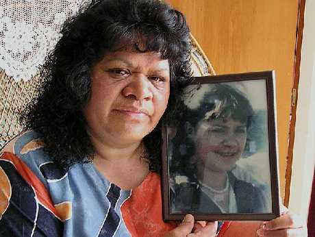 Ida Hawkins, nine years ago with a picture of her daughter, Colleen Burrows, 16, who was murdered in 1987.