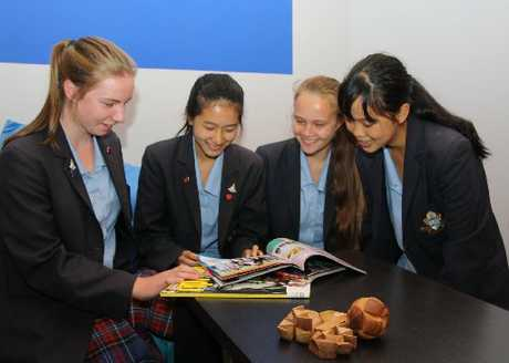 Waikato Diocesan Year 10 girls (from left) Grace Reid, Nicole Xue, Taylah Warren and Selina Smith check out some of the details in the new Rainbow Place teen hang out room they designed and funded.