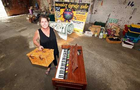 MORE GOODS PLEASE: Sandra Rickey with some of the items that have been donated for the Wanganui Chronicle's monster garage sale. PICTURE / STUART MUNRO