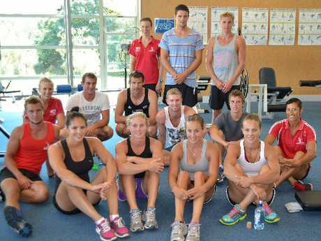 NZ Canoe Squad including Lisa Carrington (front right) with Polytechnic gym staff in red shirts, from left, Nicole McCheyne, Terri Mann and Megan Read.