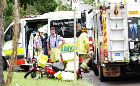 Emergency Services at a crash involving a car and a motorbike on Maryborough's Alice St.