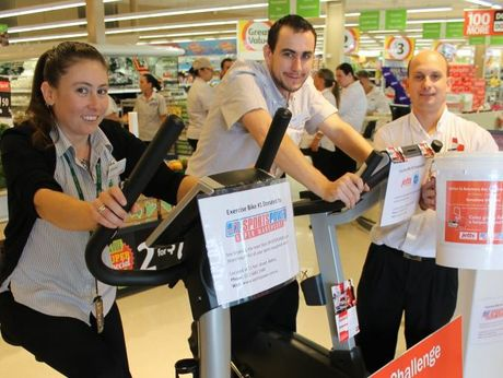 RIDING NOWHERE: Pictured are Coles, Balina, staff on their marathon exercise bike ride in store this week (from left) Simone McUnie, Samuel Smith and trainee store manager Richard Larson.
