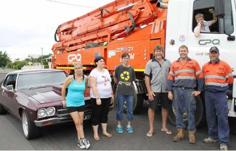 READY TO RIDE: Kirra Rice, Melissa Thompson, Nan Jaeger, Leroy Aarts, Karl Nixon, Steve Randall and Katie Legge get the truck ready for the charity poker run this weekend.