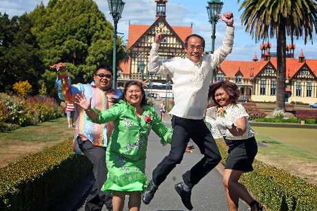 The Villasan family, from the Philippines, celebrate becoming New Zealand citizens at a Citizenship Ceremony in Rotorua yesterday.