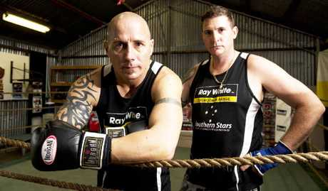 BACK IN THE SWING: Dale Ryan (left) takes a break at training this week with trainer Brett Richards at Richo's Gym.