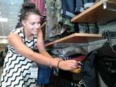 "A Tauranga clothing retail worker's quest to sustain herself in ""the real world"" is being challenged by the Government's bid to introduce a starting-out wage of $11 an hour."