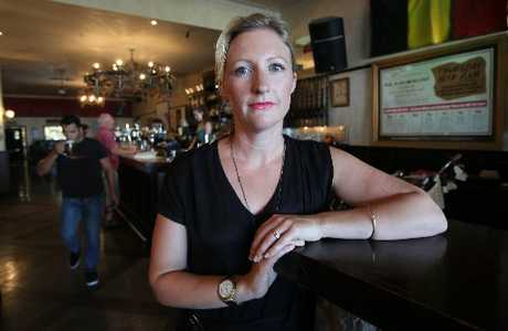 Kimberly Hayward, owner of the De Bier Haus, opposes earlier closing hours and a one-way door policy suggested by police.