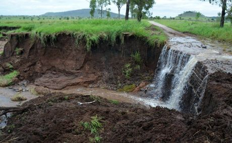 SINK HOLE: Flood waters and torrential rain have caused massive erosion on Scanlans Road, north of Gayndah. Photo Brandon Livesay / Central & North Burnett Times