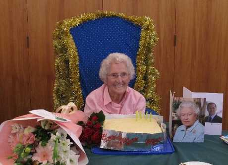 Clarice McLean with her cake and cards from the Queen and Prime Minister John Key.