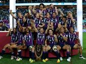 The Melbourne Storm celebrate on the podium after winning the 2012 NRL Grand Final match between the Melbourne Storm and the Canterbury Bulldogs at ANZ Stadium on September 30, 2012 in Sydney, Australia.