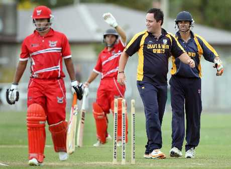 NTOB batsman Indika Senarathne (left) trudges off Nelson Park, Napier, after Havelock North&#39;s Stu McVeigh bowled him, as captain Todd Astill smiles. In the background is batsman Bronson Meehan. 