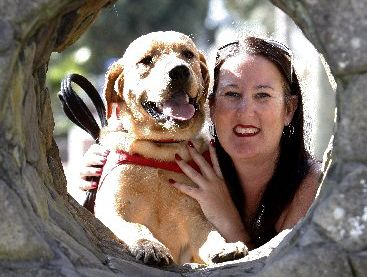 Rebecca Telfer with 8-month-old guide dog puppy, golden labrador Vic.