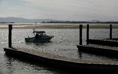 Two boaties head out from Sulphur Point boat ramp.