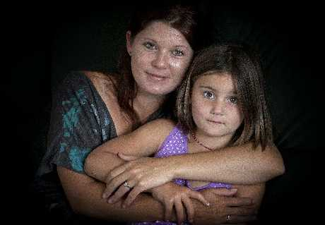 Greerton mum Cristin Sim holds on to daughter Rylie, 5.