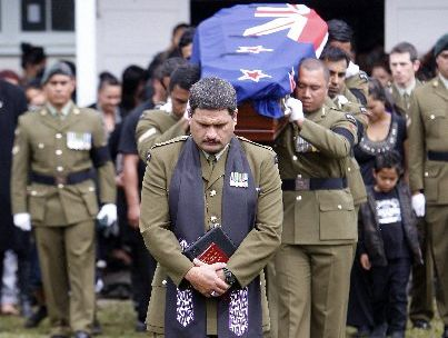 Army colleagues carry the coffin of Corporal Douglas Hughes at Pakotai last April and now his family is asking for an open inquest into his death.