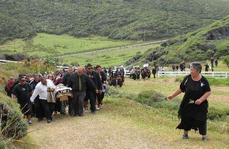"Hone Papita Raukura ""Ralph"" Hotere is carried to the top of Te Maunga Hione cemetery at Mitimiti."
