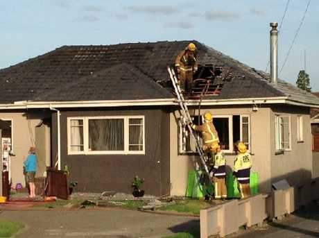 Firefighters had to tear a hole in the roof to put out a fire which had started above the ceiling.