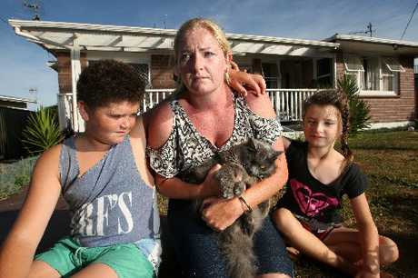 Kea St residents Annette Kelly (centre) and her children Eden McRoy, 12, (left) and Breana McRoy, 7, are keeping Astro locked inside after a spate of suspicious cat deaths.