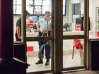 Police investigate the robbery at Bray St Red Rooster on Tuesday night.