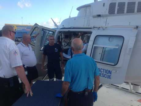 A Mt Tom man, trapped by floodwaters, is transported to Bundaberg Base Hospital by the AGL Action Rescue Helicopter. Photo Contributed