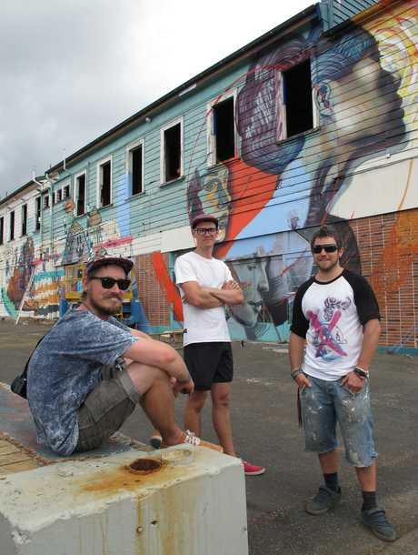 Spray artists Cinzah Merkens (left, artist name Seekayem), Misha Uteev (Wert 159) and Simon Ormerod (Cracked Ink) halfway through their transformation of the Kaikohe Hotel.