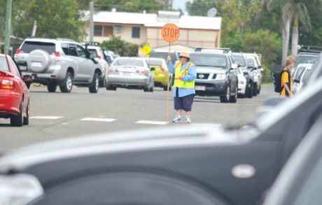 MATHS DON'T ADD UP: Traffic chaos on Williams St as up to 500 parents compete for 32 car parks around the North Blackwater State School on a daily basis.
