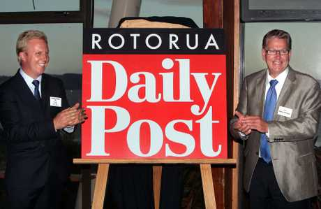 MP Todd McClay (left) and Mayor Kevin Winters reveal the new masthead.