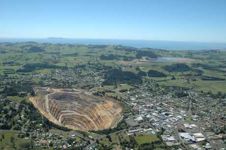 From the air the vaste open pit of the Martha mine dominates the town of Waihi.