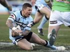 DESPITE knocking back a bigger offer from the Panthers, Todd Carney's manager said his client was delighted to re-sign at Cronulla for another five years.