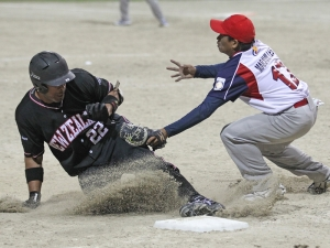 Donny Hale slides into third base against the Philippines.