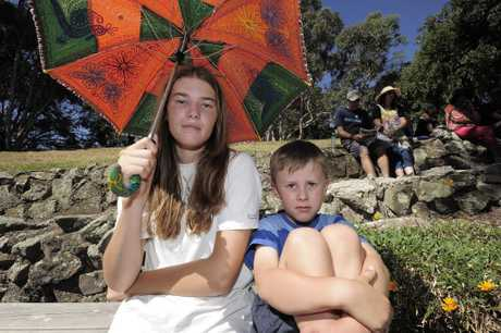 DAY OUT: Warmarie Ellis, 14, and Joel Mcgrath, 6, stay out of the sun at the Picnic in the Park.