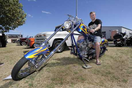 MOTORCYCLE HEAVEN: Paul Collins sits astride his rare Orange County Chopper.