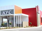 A TEENAGER is alleged to have jumped the counter at a KFC restaurant and punched a worker.