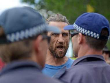 A protester screams at Police at The Doubtful Creek CSG mining site.