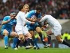 Luke McLean of Italy is tackled by Ben Youngs of England during the RBS Six Nations match England and Italy at Twickenham Stadium on March 10, 2013 in London, England.