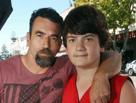 GRATEFUL: Napier&#39;s Shane McQuoid with his son Joshua, 12, who was rescued from the rough Marine Parade surf.