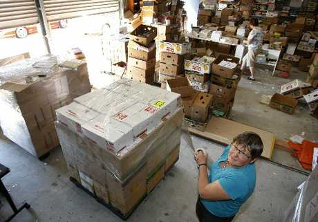 BIG READ: Corrine Angus loading up a pallet with books bound for Fiji schools.