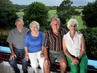 Long-term local residents (left) Neil and Betty Garrett and Ron and Florence Taylor at the Taylors' property overlooking cane fields on Petrie Creek Rd, Rosemount.