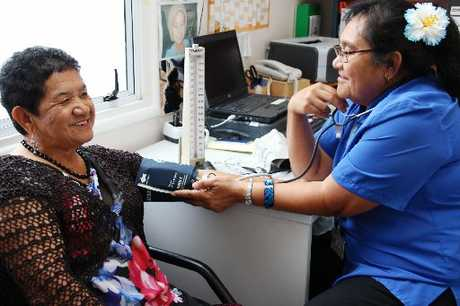 CHECK UP: Viv Kahi (left) has her blood pressure checked by Clinical Nurse Specialist Tafale Maddren.