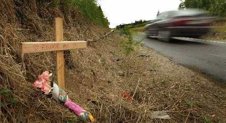 A cross was placed on Welcome Bay Rd after a crash in which two sisters, Brooklyn Clark and Merepeka Morehu, were killed.