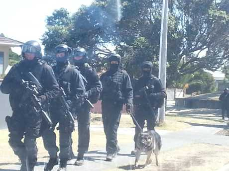 The armed offenders squad surrounded two homes on a peaceful Mount Maunganui street.