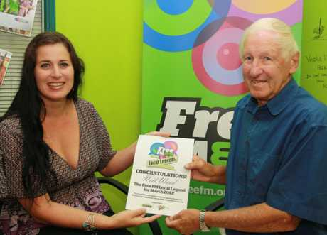 FreeFM breakfast co-host Raquel Martin presents local sailing legend Neil Wood with his certificate.
