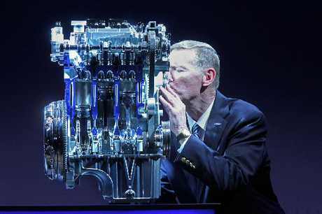  Ford GM Alan Mulally kisses a three-cylinder engine. 