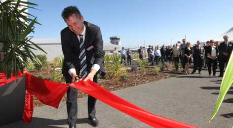 LIFT-OFF: Napier MP Chris Tremain does the honours at the opening of a branch of one of the world's biggest engineering firms in Napier. HBT131232-15