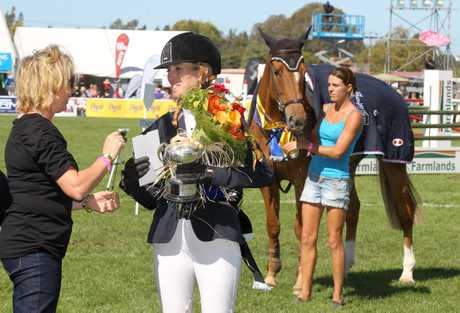 Katie McVean and Dunstan Springfield celebrate their Lady Rider title win at the Horse of the Year in Hastings yesterday.