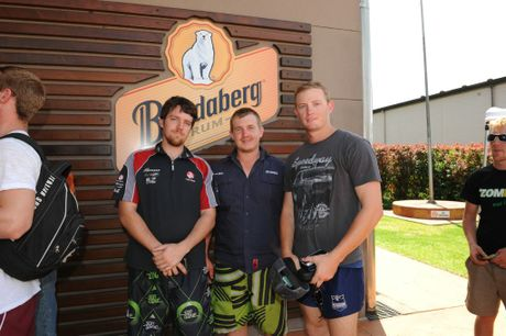 ROAD TO RECOVERY: Michael Lowe, Josh Walker and Nathan McCrae queued overnight for their bottle of rum at the Bundaberg Distillery. Photo: Mike Knott / NewsMail