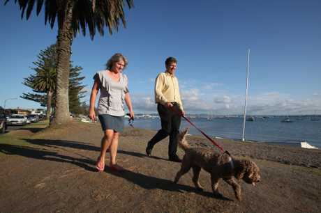 DOG WALKERS: Greg and Carol Delaney walk their dog Molly along Pilot Bay.