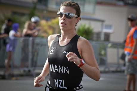 TOP EFFORT: Women's winner Terri Mann in yesterday's Marra Triathlon. INSET: Leading trio in the men's race of the Marra Triathlon, from left, Owen Miller, Michael Pugh and Aiden Dunster.