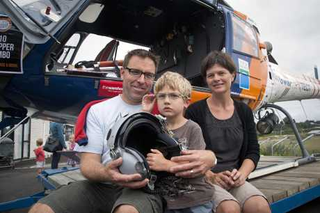 OPEN DAY: Mark and Belinda Edgecombe took helicopter fan Louis, 4, to have his photo taken with the TrustPower TECT Rescue Helicopter.